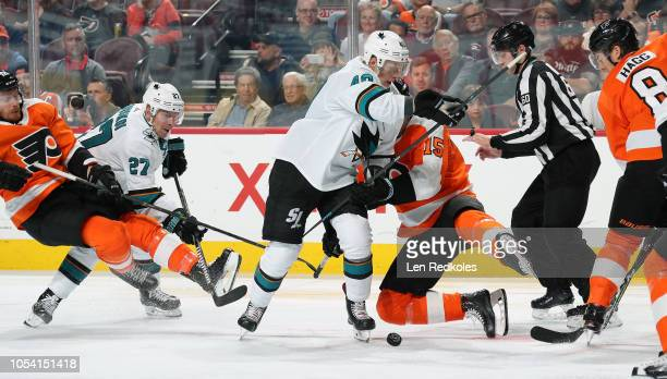 Jori Lehtera Michael Raffl and Robert Hagg of the Philadelphia Flyers battle for the puck on a faceoff against Antti Suomela and Joonas Donskoi of...