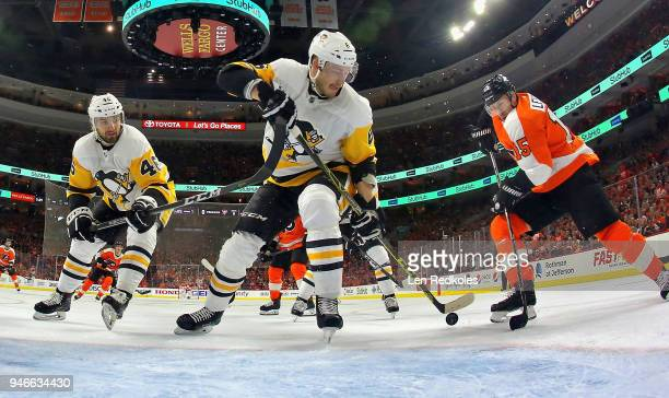 Jori Lehtera of the Philadelphia Flyers battles for the loose puck in front of the net with Zach AstonReese and Jamie Oleksiak of the Pittsburgh...