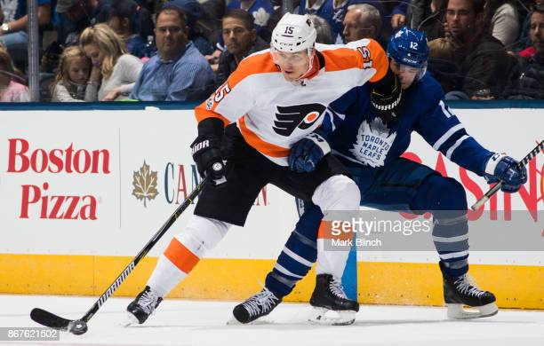 Jori Lehtera of the Philadelphia Flyers battles with Patrick Marleau of the Toronto Maple Leafs during the second period at the Air Canada Centre on...