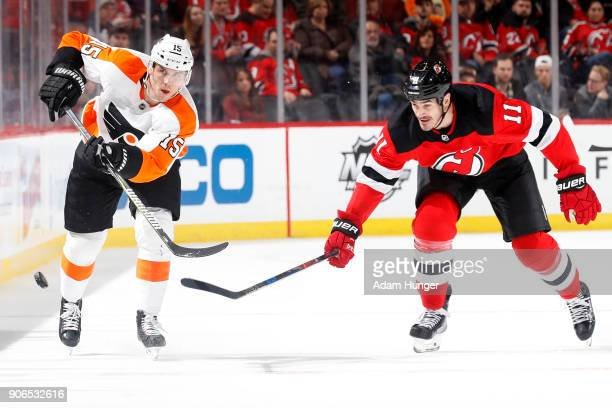 Jori Lehtera of the Philadelphia Flyers in action in front of Brian Boyle of the New Jersey Devils during the first period at the Prudential Center...