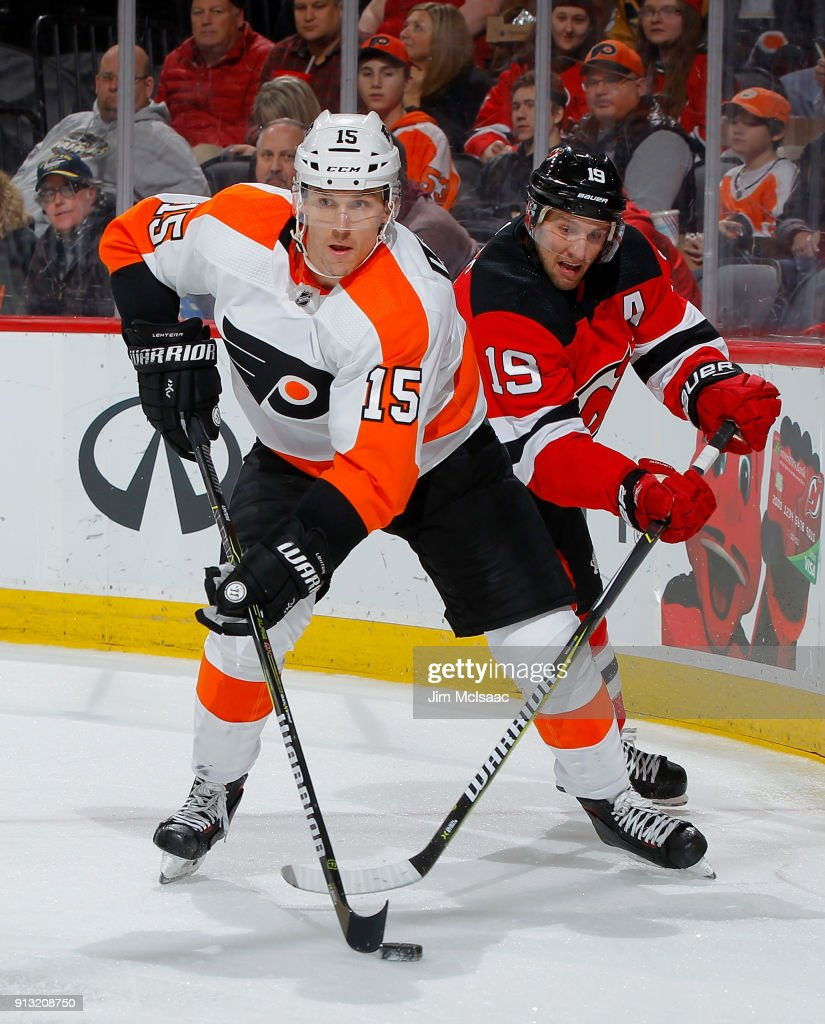 Jori Lehtera #15 of the Philadelphia Flyers plays the puck against Travis Zajac #19 of the New Jersey Devils on February 1, 2018 at Prudential Center in Newark, New Jersey.