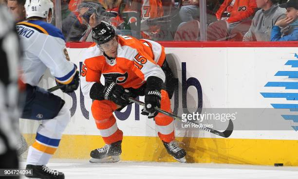 Jori Lehtera of the Philadelphia Flyers reaches for the puck along the boards against the St Louis Blues on January 6 2018 at the Wells Fargo Center...
