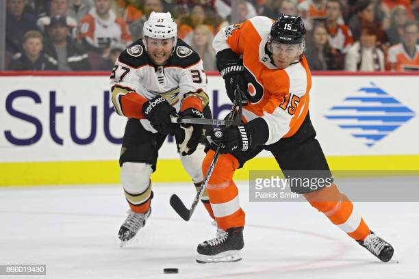 Jori Lehtera of the Philadelphia Flyers shoots in front of Nick Ritchie of the Anaheim Ducks during the second period at Wells Fargo Center on...