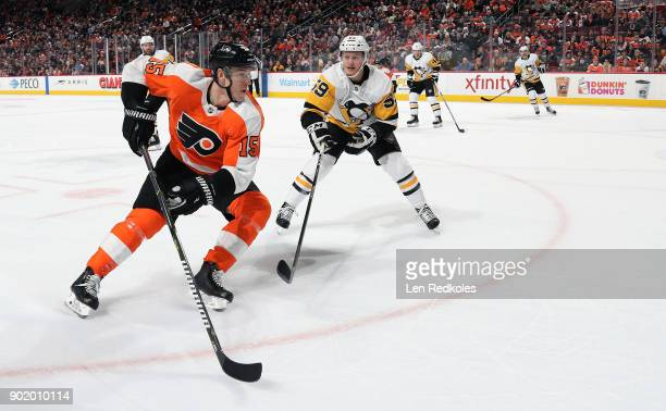 Jori Lehtera of the Philadelphia Flyers skates against Jake Guentzel of the Pittsburgh Penguins on January 2 2018 at the Wells Fargo Center in...