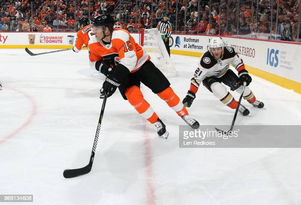 Jori Lehtera of the Philadelphia Flyers skates the puck against Chris Wagner of the Anaheim Ducks on October 24 2017 at the Wells Fargo Center in...