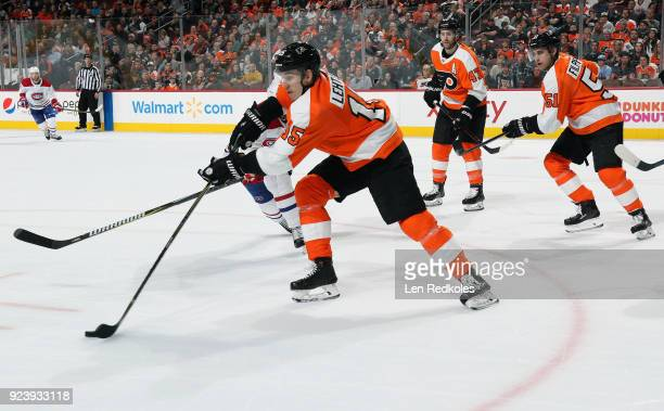Jori Lehtera of the Philadelphia Flyers skates the puck with Andrew MacDonald and Valtteri Filppula against the Montreal Canadiens on February 20...