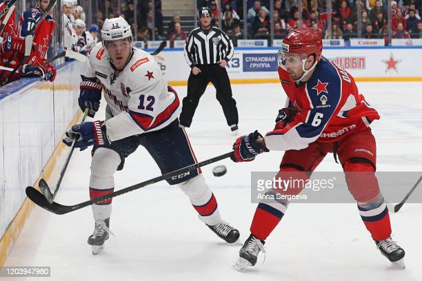 Jori Lehtera of the SKA Saint Petersburg battles for the puck against Klas Dahlback of the CSKA at the Arena CSKA Moscow on January 21, 2020 in...