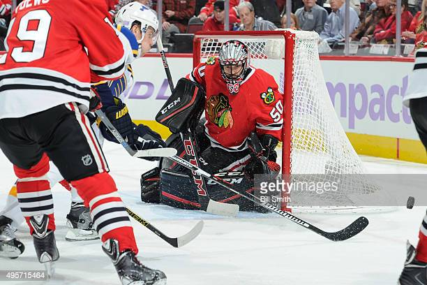 Jori Lehtera of the St. Louis Blues chases the puck past goalie Corey Crawford of the Chicago Blackhawks in the second period of the NHL game at the...