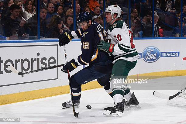 Jori Lehtera of the St. Louis Blues passes the puck against Ryan Suter of the Minnesota Wild at the Scottrade Center on February 6, 2016 in St....