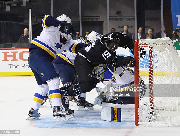 Jori Lehtera of the St Louis Blues pushes Cal Clutterbuck of the New York Islanders into Jake Allen during the second period at the Barclays Center...