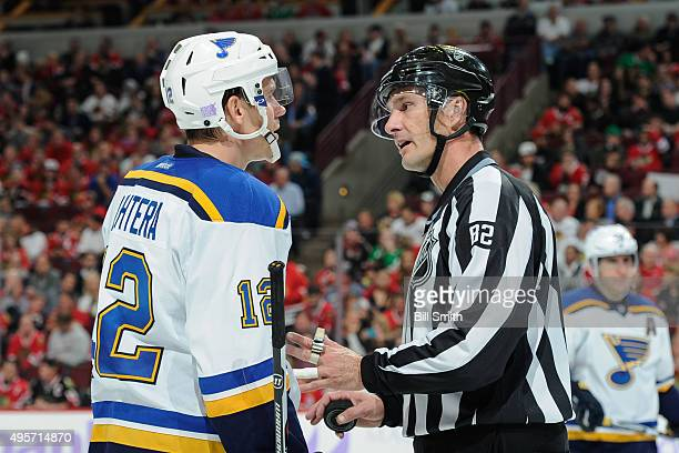 Jori Lehtera of the St. Louis Blues speaks with linesman Ryan Galloway in the second period of the NHL game against the Chicago Blackhawks at the...