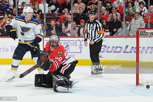 Jori Lehtera of the St. Louis Blues watches as the puck gets past goalie Corey Crawford of the Chicago Blackhawks for a goal in overtime of the NHL...