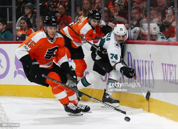 Jori Lehtera Scott Laughton of the Philadelphia Flyers and Dylan Demelo of the San Jose Sharks battle for the loose puck along the boards on November...