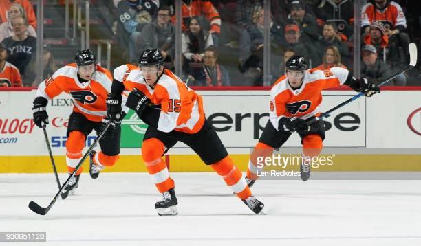 Jori Lehtera Valtteri Filppula and Ivan Provorov of the Philadelphia Flyers skate against the Pittsburgh Penguins on March 7 2018 at the Wells Fargo...