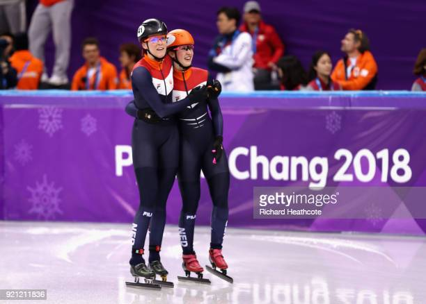 Jorien ter Mors and Suzanne Schulting of the Netherlands celebrate victory during the Ladies Short Track Speed Skating 3000m Relay Final B on day...