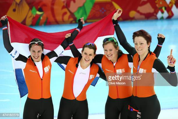 Jorien ter Mors Ireen Wust Marrit Leenstra and Lotte van Beek of the Netherlands celebrate winning the gold medal during the Women's Team Pursuit...