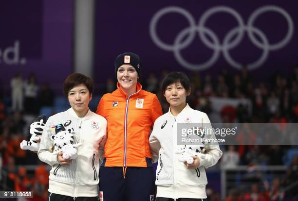 Jorien Ter Mors of the Netherlands celebrates winning the gold medal with silver medallist Nao Kodaira of Japan and bronze medallist Miho Takagi of...