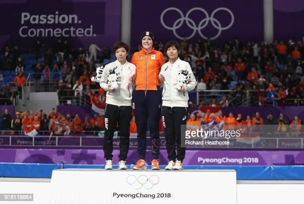 Jorien Ter Mors of the Netherlands celebrates winning the gold medal with silver medallist Nao Kodaira of Japan and bronze medallist Miho Takagi of...