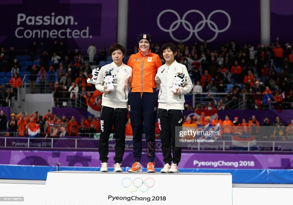 Jorien Ter Mors (C) of the Netherlands celebrates winning the gold medal with silver medallist Nao Kodaira (L) of Japan and bronze medallist Miho Takagi of Japan during the victory ceremony for the Ladies' 1000m Speed Skating on day five of the PyeongChang 2018 Winter Olympics at Gangneung Oval on February 14, 2018 in Gangneung, South Korea.