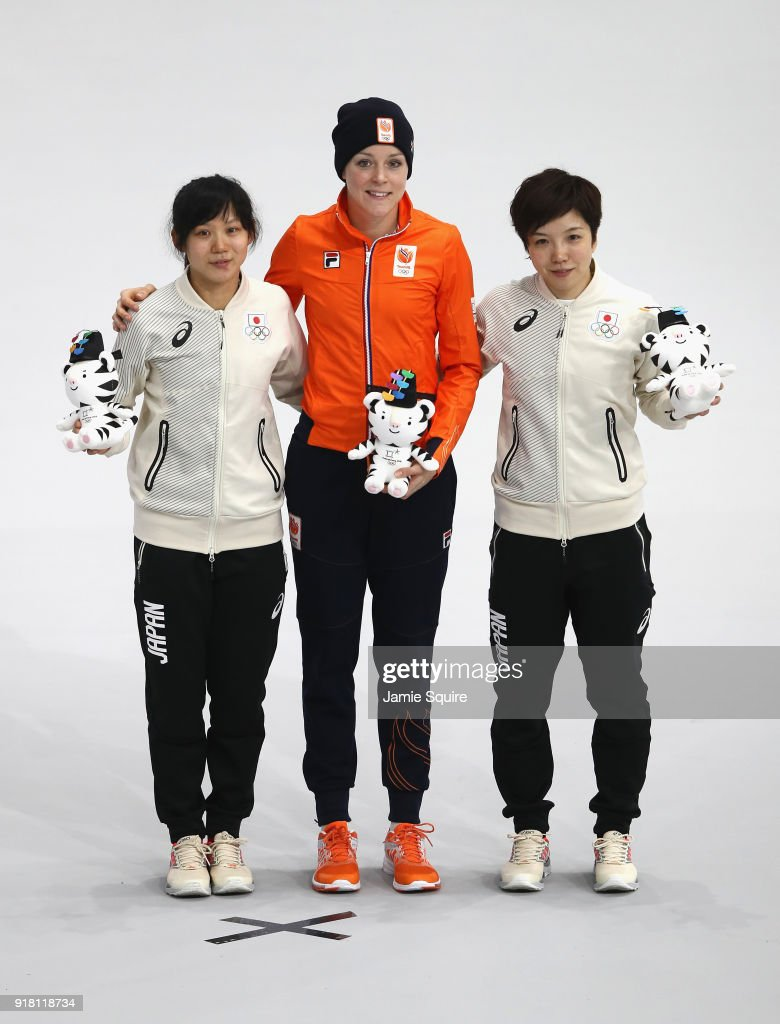 Jorien Ter Mors (C) of the Netherlands celebrates winning the gold medal with silver medallist Nao Kodaira (R) of Japan and bronze medallist Miho Takagi of Japan during the victory ceremony for the Ladies' 1000m Speed Skating on day five of the PyeongChang 2018 Winter Olympics at Gangneung Oval on February 14, 2018 in Gangneung, South Korea.