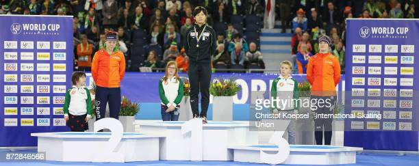Jorien ter Mors of the Netherlands poses during the medal ceremony after winning the 2nd place Miho Takagi of Japan poses during the medal ceremony...