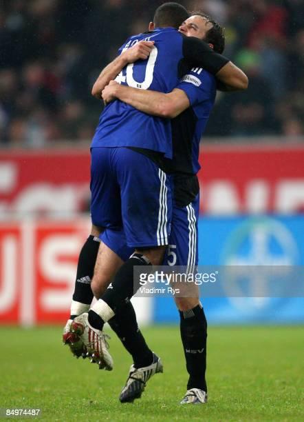 Joris Mathijsen and Dennis Aogo of Hamburg celebrate after winning 1:2 the Bundesliga match between Bayer Leverkusen and Hamburger SV at the LTU...