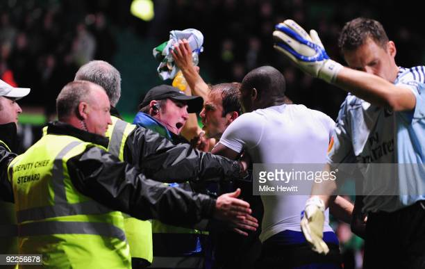 Joris Mathijsen Guy Demel and goalkeeper Frank Rost of Hamburger SV argues with Celtic stewards at the end of the UEFA Europa League Group C match...