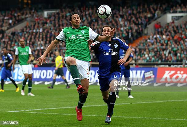 Joris Mathijsen of Hamburg and Claudio Pizarro of Bremen battle for the ball during the Bundesliga match between SV Werder Bremen and Hamburger SV at...