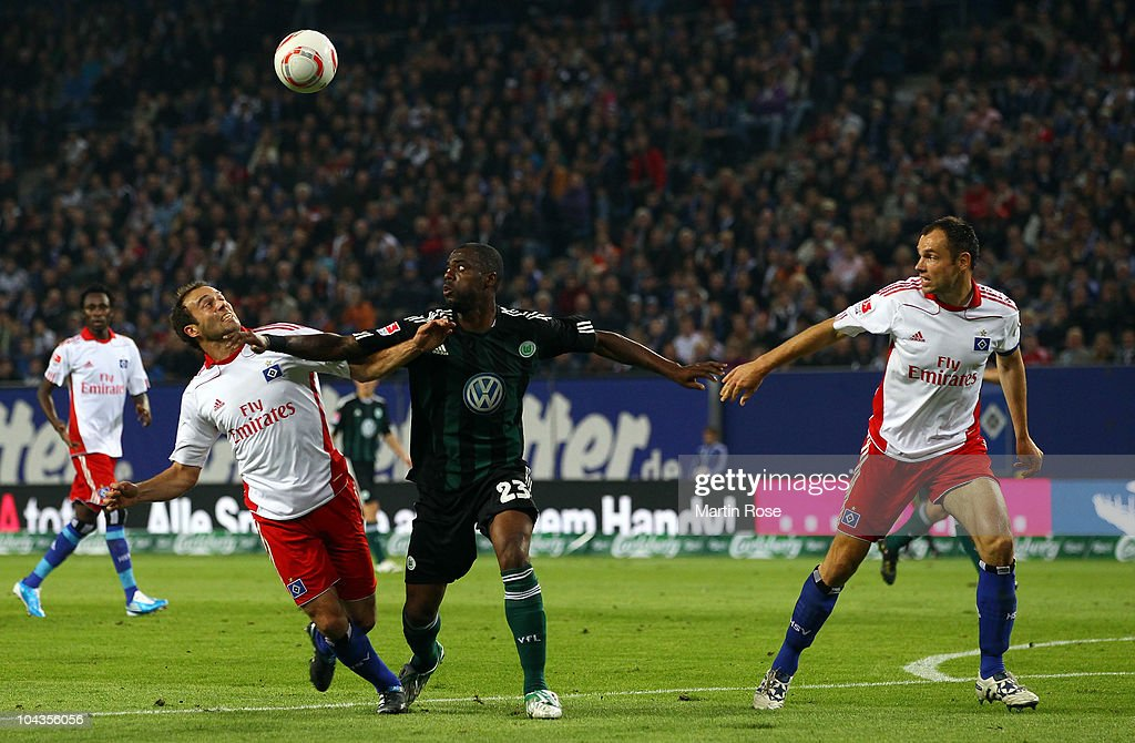 Joris Mathijsen (L) of Hamburg and Grafite (C) of Wolfsburg battle for the ball during the Bundesliga match between Hamburger SV and VFL Wolfsburg at Imtech Arena on September 22, 2010 in Hamburg, Germany.