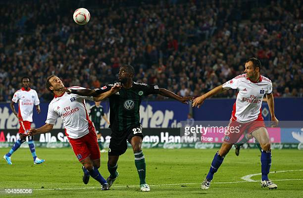 Joris Mathijsen of Hamburg and Grafite of Wolfsburg battle for the ball during the Bundesliga match between Hamburger SV and VFL Wolfsburg at Imtech...