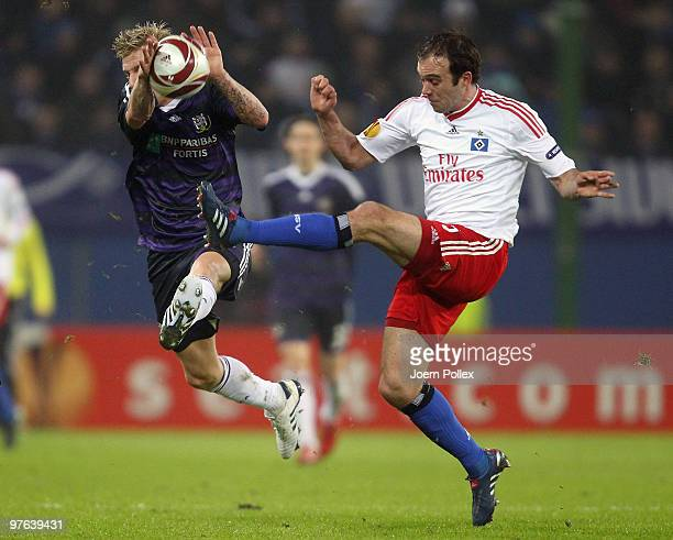 Joris Mathijsen of Hamburg and Jonathan Legear of Anderlecht battle for the ball during the UEFA Europa League round of 16 first leg match between...