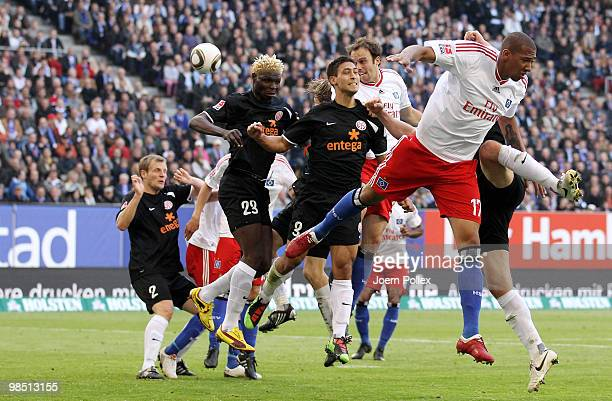 Joris Mathijsen of Hamburg as well as Aristide Bance and Malik Fathi of Mainz and Jerome Boateng of Hamburg compete for the ball during the...