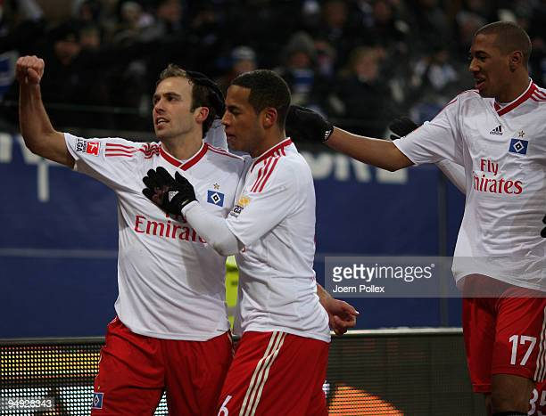Joris Mathijsen of Hamburg celebrates with his team mates Dennis Aogo and Jerome Boateng after scoring his team's first goal during the Bundesliga...