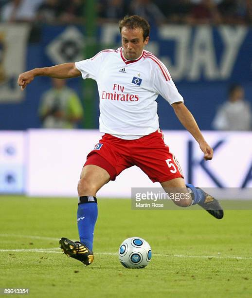 Joris Mathijsen of Hamburg runs with the ball during the UEFA Europa League second leg match between Hamburger SV and Randers FC at HSH Nordbank...