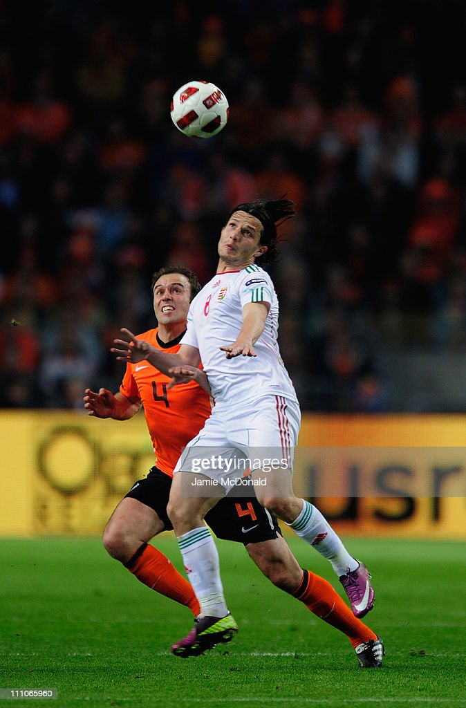 Joris Mathijsen of Netherlands battles with Gergely Rudolf of Hungary during the Group E, EURO 2012 Qualifier between Netherlands and Hungary at the Amsterdam Arena on March 29, 2011 in Amsterdam, Netherlands.