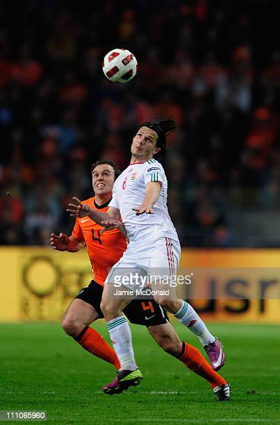 Joris Mathijsen of Netherlands battles with Gergely Rudolf of Hungary during the Group E EURO 2012 Qualifier between Netherlands and Hungary at the...
