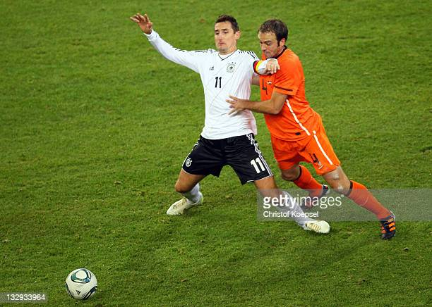 Joris Mathijsen of Netherlands challenges Miroslav Klose L9 of Germany during the International Friendly match between Germany and Netherlands at...