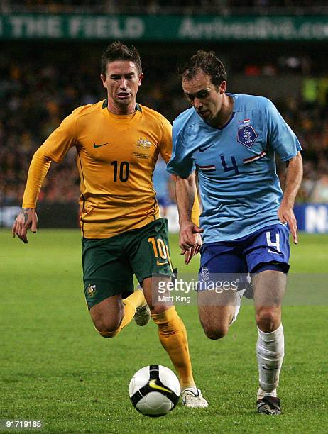 Joris Mathijsen of the Netherlands controls the ball in front of Harry Kewell of the Socceroos during the International friendly football match...