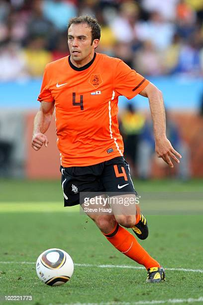Joris Mathijsen of the Netherlands runs with the ball during the 2010 FIFA World Cup South Africa Group E match between Netherlands and Japan at...