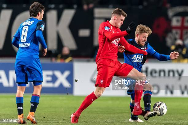 Joris van Overeem of AZ Marko Kvasina of FC Twente Fredrik Midtsjo of AZ during the Dutch Eredivisie match between FC Twente Enschede and AZ Alkmaar...