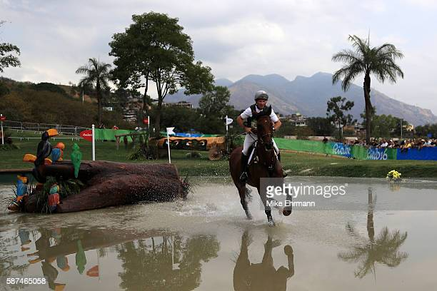 Joris Vanspringel of Belgium riding Lully Des Aulnes clears a jump during the Cross Country Eventing on Day 3 of the Rio 2016 Olympic Games at the...