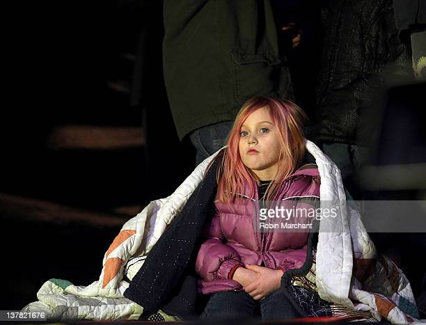 Jorja Bleu Sychak watches father Bret Michaels perform during day 1 of the Super Bowl Village on January 27 2012 in Indianapolis Indiana