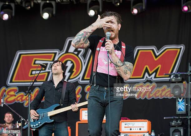 Jorma Vik Matt McJunkins and Jesse Hughes of the band Eagles of Death Metal perform at Centennial Olympic Park on May 15 2016 in Atlanta Georgia