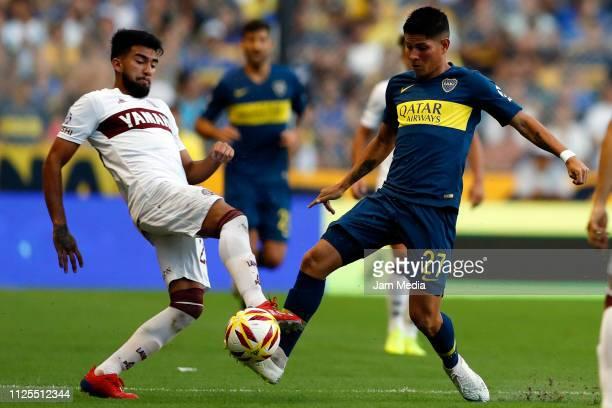 Jorman Campuzano de Boca Juniors fights for the ball with Pasquini Nicolas of Lanus during a match between Boca Juniors and Lanus as part of...