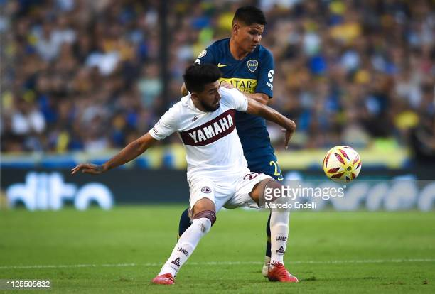 Jorman Campuzano of Boca Juniors fights for the ball with Marcelino Moreno of Lanus during a match between Boca Juniors and Lanus as part of...