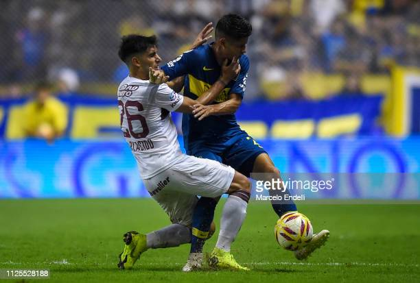 Jorman Campuzano of Boca Juniors fights for the ball with Nicolas Di Placido of Lanus during a match between Boca Juniors and Lanus as part of...