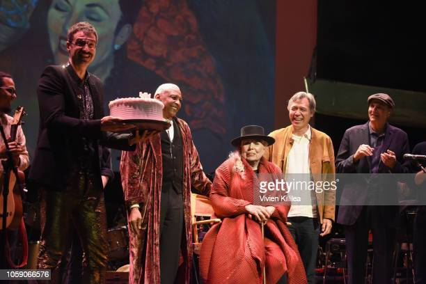 Jorn Weisbrodt Charles Valentino Joni Mitchell Sauchuen and James Taylor celebrate onstage at Joni 75 A Birthday Celebration Live At The Dorothy...