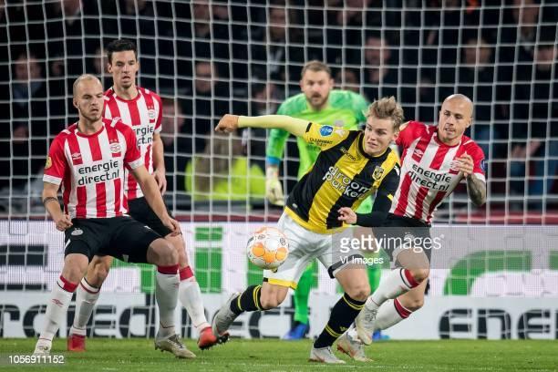 Jorrit Hendrix of PSV Martin Odegaard of Vitesse Jos çngel Tasende Angelino of PSV during the Dutch Eredivisie match between PSV Eindhoven and...