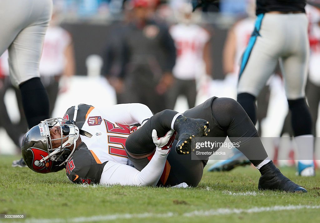 Jorvorskie Lane #46 of the Tampa Bay Buccaneers holds his leg after being injured on a play in the first quarter of their game against the Carolina Panthers at Bank of America Stadium on January 3, 2016 in Charlotte, North Carolina.