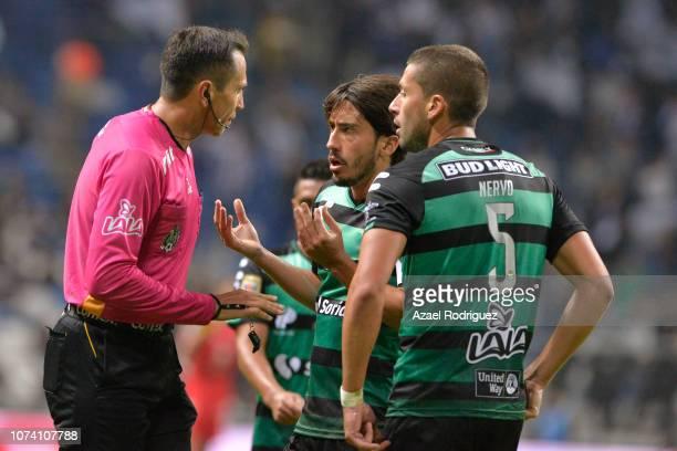 José Abella of Santos argues with referee Luis Enrique Santander during the quarter finals first leg match between Monterrey and Santos Laguna as...
